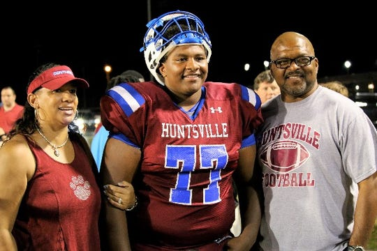 Jalen Spady shares a moment with his parent James and Barbara Spady at Huntsville High School in Huntsville, Ala. James is now an assistant coach at FAMU. Jalen plays on the offensive line