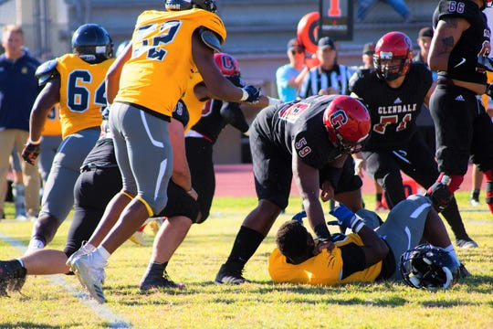 Jalen Spady flattens a defender while playing at Glendale Community College. Spady is now on the roster at FAMU.
