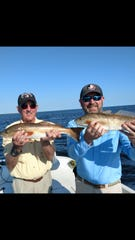 L-R  Mark Hillis and Mike Dasher with two of the many redfish caught and released while fishing with guide Junior Dice.