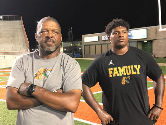 FAMU associate head coach/tight ends coach James Spady (left) observes the action during practice with his son Jalen. The son is playing his first season at FAMU as an offensive lineman.