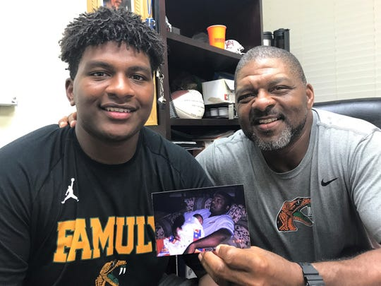 FAMU assistant coach James Spady loves the connection with his son Jalen playing guard at FAMU. The father holds a photo of his son when he was three days old in his office.
