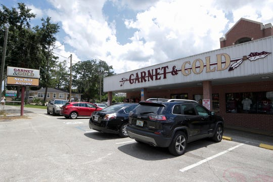 """Guy Moore, the owner of Garnet and Gold, said, """"ÒThe timing of the closure of Pensacola Street is unconscionable."""""""