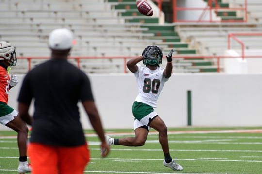FAMU wide receiver Marcus Williams eyes a reception during the Beanie Bowl Thursday, Aug. 22, 2019.