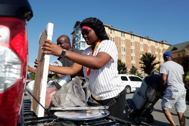 Ayeisha Fils, an incoming freshman at FAMU, and her father Edd Fils unload the back of their pick-up truck as they move Ayeisha into her dorm room Thursday, Aug. 22, 2019.