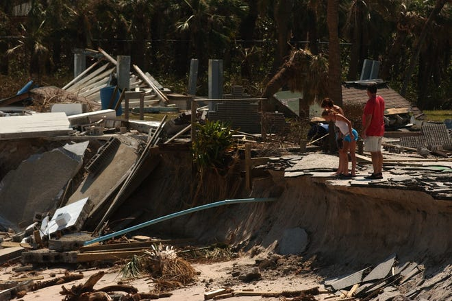 After being allowed to return to the barrier island, many people took time to view the destruction caused by Hurricane Jeanne, which caused even more damage at Wabasso Beach Park seen here Sept. 28, 2004, in Indian River County.