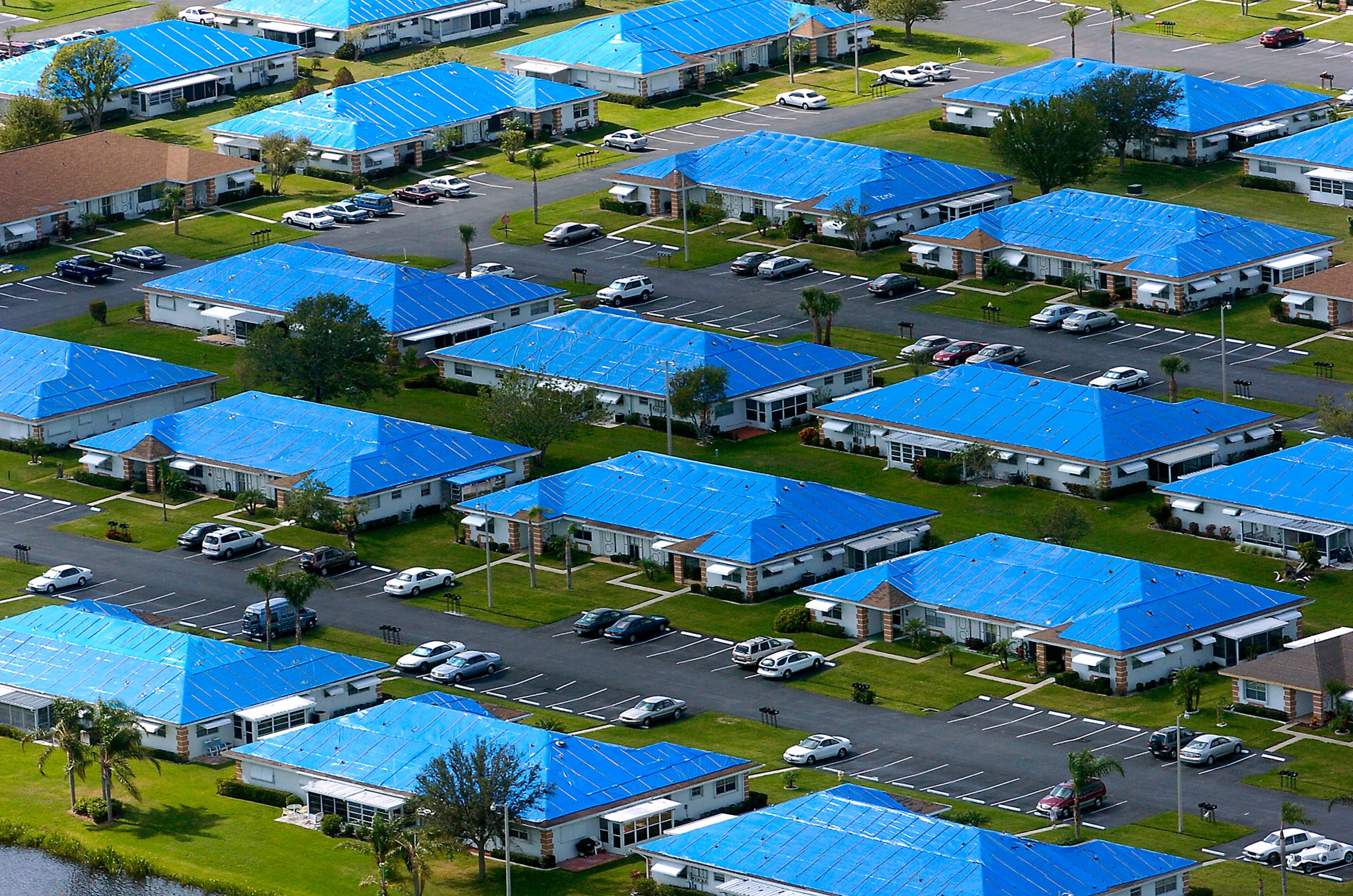 Rows of damaged homes near Savannas State Preserve were covered in blue roofs on Nov. 22, 2004, in Fort Pierce. After two hurricanes passed through the Treasure Coast, many homes were left with damaged roofs and residents were forced to use blue roofs to keep the rain out.