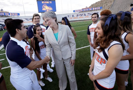 New UTEP President Heather Wilson is welcomed to the Sun Bowl on Thursday morning, Aug. 22, 2019, by the UTEP cheerleader team during the Morning With the Miners breakfast.