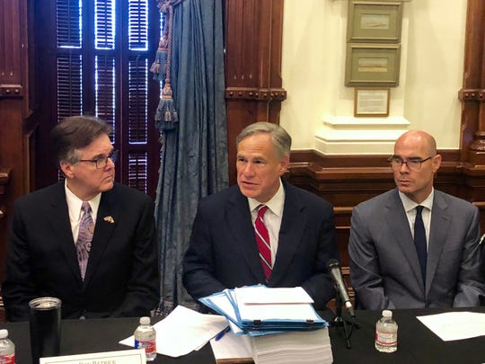Gov. Greg Abbott, center, was joined by Lt. Gov. Dan Patrick, left, and House Speaker Dennis Bonnen at an Aug. 22, 2019, roundtable meeting in Austin held after the Aug. 3, 2019, mass shooting in El Paso.