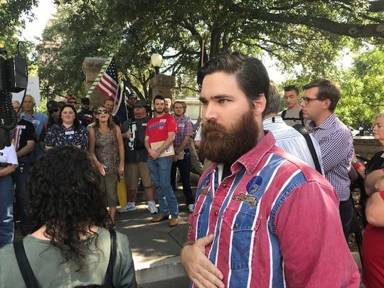 Devon Bailey confronted pro-gun demonstrators outside the Texas Capitol, saying more weapons are not the answer to mass shootings, Aug. 22, 2019.