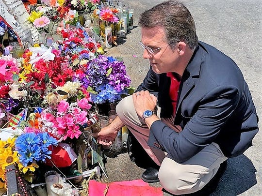 Jeffrey Dion, executive director of the National Compassion Fund, Aug. 22 visited the makeshift shooting victims' memorial behind the Cielo Vista Walmart store, where the Aug. 3 mass shooting occurred.