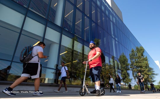 Students head to their first day of classes at Fresno State in this Wednesday, Aug. 21, 2019 file photo.