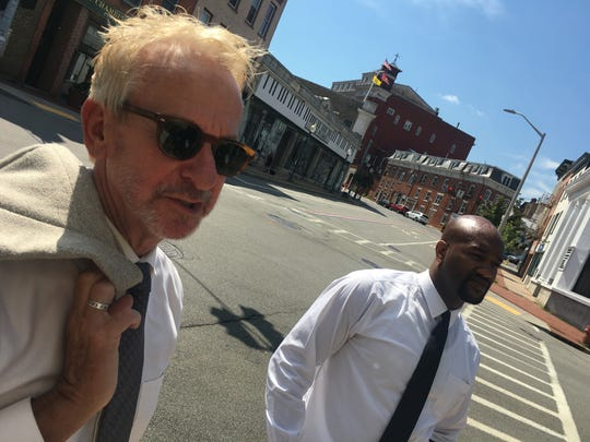 Peekskill City Manager Richard Leins, left, and Mayor Andre Rainey during a walking tour of the city's downtown Thursday looking at potential uses for the $10 million Peekskill recently received from the state for revitalization.