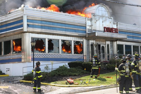 Flames and smoke pour from the Landmark Diner on Route 9 in Briarcliff Manor, Thursday, Aug. 22, 2019.