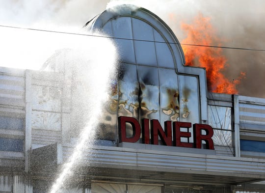 The Art Deco facade begins to melt as Briarcliff Manor and mutual aide firefighters battle an intense fire at the Landmark Diner on Route 9 in Briarcliff Manor, Aug. 22, 2019.