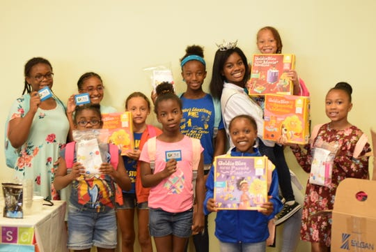 Jacqueline Means, STEM Queen and the 2019 Miss Delaware's Outstanding Teen with some of the girls who attended one of her science weekends. The Southbridge teen hopes to inspire young girls of color to pursue careers in STEM (science, technology, engineering and math) because the fields are predominantly male and white.