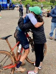 Aaron McDaniel being congratulated by his wife, Tatum, after his National Championship winning ride earlier this year.