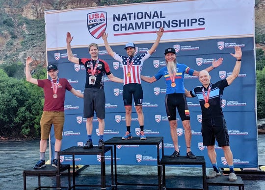 Aaron McDaniel on the podium on May 11 being awarded his National Championship award in the 2019 USA Cycling Mountain Bike Marathon Singlespeed Men's event in Palo Duro Canyon, Texas.