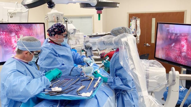 A doctor at Genesis Hospital uses a ORBEYE microscope during surgery. The microscope provides a live 3D 4K view during brain and spinal surgeries.