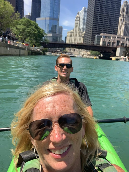 USA TODAY travel reporter Dawn Gilbertson and her son, Jack, kayaking on the Chicago River.