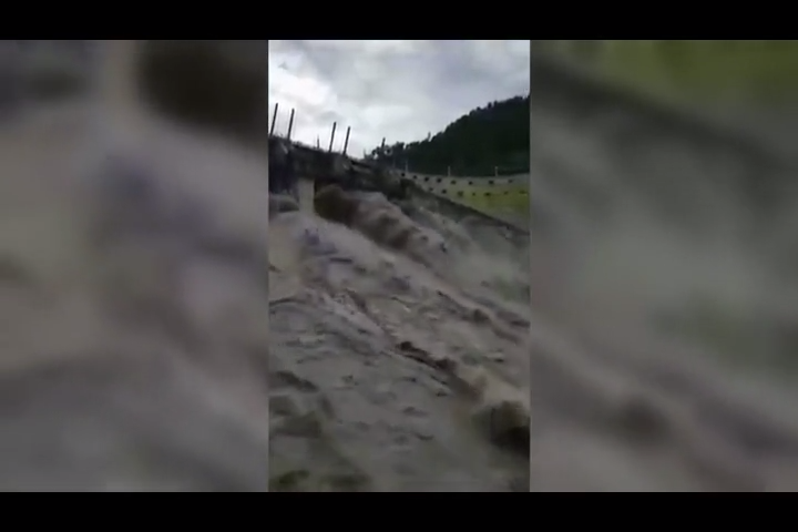 Floodwater appears to defy gravity as it gushes uphill from India dam