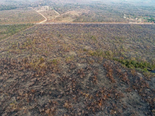 An aerial view Aug. 20, 2019, of an area of land that has been scorched by fire in the state of Mato Grosso, Brazil. According to media reports, the Brazilian Amazon region is suffering a record amount of fires, with an 84% increase on the same period last year.