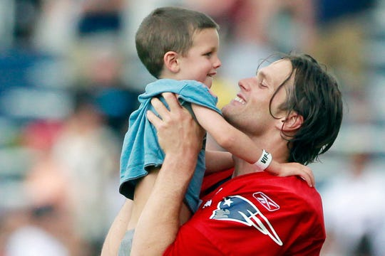 A throwback of photo of Tom Brady and his son Jack. Jack is now 12 years old and is looking more and more like his dad.