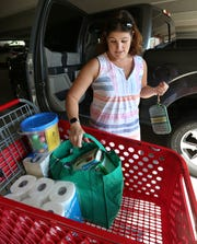 Teacher Lauren Moskowitz loads her car with items purchased at a Rockville, Md. Target on Aug. 18, 2019.