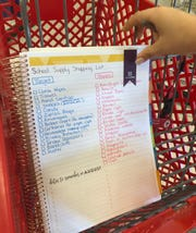 Ali Daniels, a math teacher at Eastern Middle School in Silver Spring, Maryland, shows off her back-to-school shopping list for her classroom.