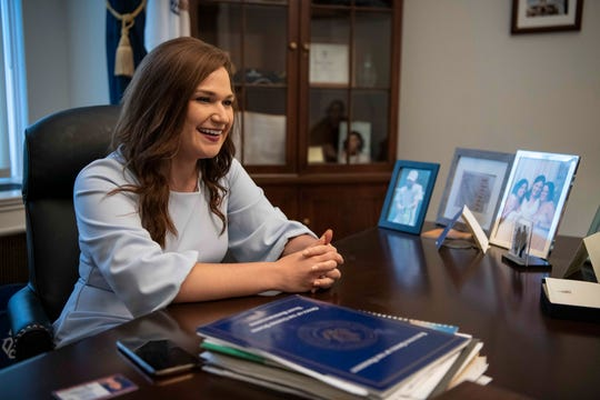 Washington, DC  --  Rep. Abby Finkenauer, D-Iowa, sits surrounded by photos of her friends and family and other mementos including Michelle Obama's book in her office on Capitol Hill on June 27, 2019. The moderate Democrat is the only freshman to chair a subcommittee, and is the second-youngest person to serve in Congress. --    Photo by Hannah Gaber, USA TODAY