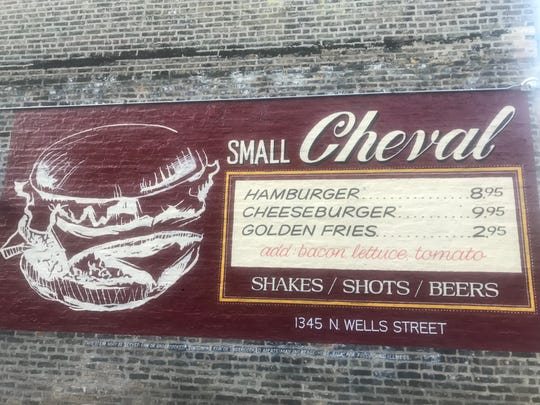 The menu at Small Cheval in Chicago's Old Town, a casual offshoot of  popular Au Cheval, is painted on the wall outside.