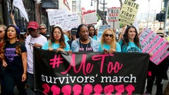 People protest sexual assault and harassment at the #MeToo March in Hollywood on Nov. 12, 2017.
