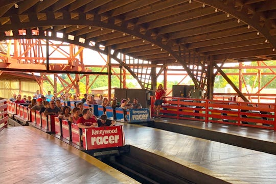 "Known as a ""Mobius"" coaster, Racer actually has one, continuous track. Trains that depart on the left side of the station return on the right, and vice-versa."