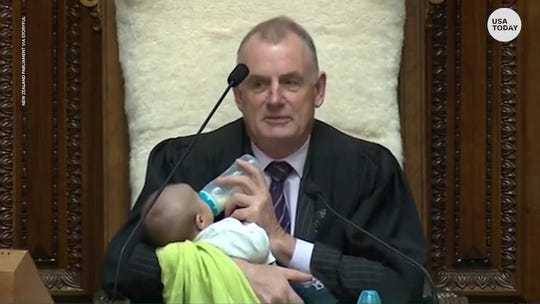 Awww! New Zealand lawmaker baby-sits colleague's newborn while presiding over Parliament