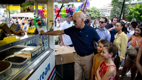 Former Vice President Joe Biden buys an ice cream Wonder Bar for himself and sisters Grace and Noelle Beasley, of Urbandale, on the first day of the Iowa State Fair on Thursday, Aug. 8, 2019, in Des Moines, Iowa.