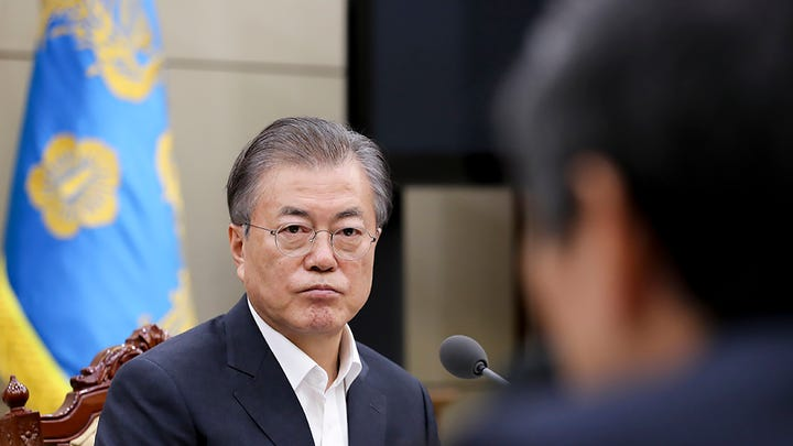 In this photo provided by South Korea Presidential Blue House, South Korean President Moon Jae-in listens a report from officials about the General Security of Military Information Agreement, or GSOMIA, at the Presidential Blue House in Seoul, South Korea, Thursday, Aug. 22, 2019.  South Korea will stop exchanging classified intelligence on North Korea with Japan amid a bitter trade dispute, an official said Thursday, a surprise announcement that is likely to set back U.S. efforts to bolster security cooperation with two of its most important allies in the Asian region.