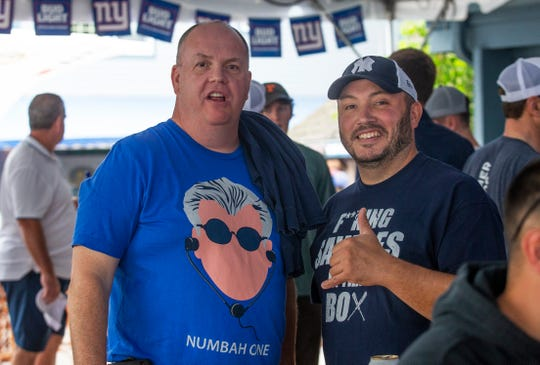 Tom Mahoney and Craig Bagley, both of Old Bridge, enjoy themselves at the WFAN show. People attend the WFAN's Mike Francesa Summer Send-Off show at Bar Anticipation in Lake Como, NJ on August 23, 2019.