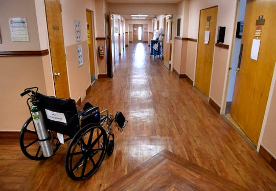 A wheelchair sits in a corner of Haskell Memorial Hospital.