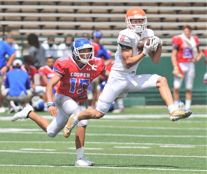 A San Angelo Central receiver makes a catch in front of Cooper's Dylon Davis during a scrimmage Friday, Aug. 23, 2019, at Shotwell Stadium.