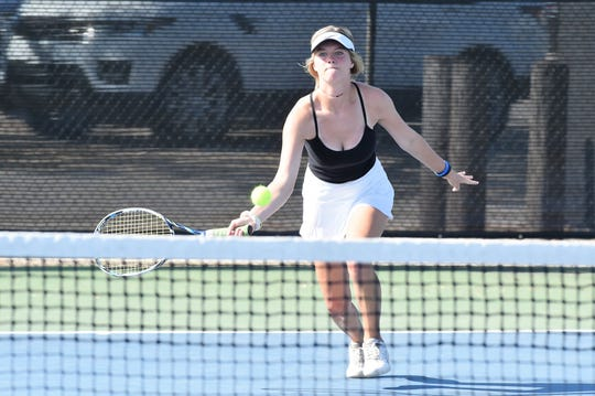 Abilene High's Addison Brewer runs up to hit a shot at the net against Odessa Permian in the first round of the AISD Team Tennis Tournament on Aug. 23. Brewer won 6-1, 6-0 at No. 5 singles as the Eagles won 19-0.