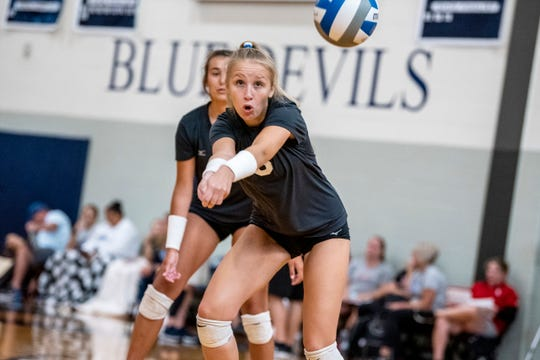 Lakeview junior Faith McClung (5) bumps the ball on Friday, Aug. 23, 2019 at Gull Lake High School.