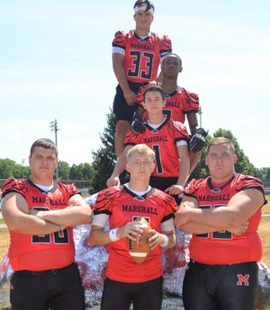 The 2019 Marshall Redhawks will be led by key returners, front row, from left, Tyler Day, Codey Shellenberger, Harrison Hautau. Above, from top, Justin Hankey, Thaian Taylor and Ben Lee.