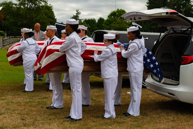 Sailors assigned to the Naval Base Kitsap Funerals and Honors Division carry the remains of two brothers, Seaman 2nd Class Calvin H. Palmer and Seaman 2nd Class Wilfred D. Palmer, during a repatriation ceremony at Sunset Lane Cemetery on Aug. 9. The Palmer brothers perished when their battleship, USS Oklahoma, was attacked by Japanese aircraft at Pearl Harbor on Dec. 7, 1941. Their remains went unidentified until they were exhumed for analysis from the National Memorial Cemetery of the Pacific in Honolulu, Hawaii in 2015.