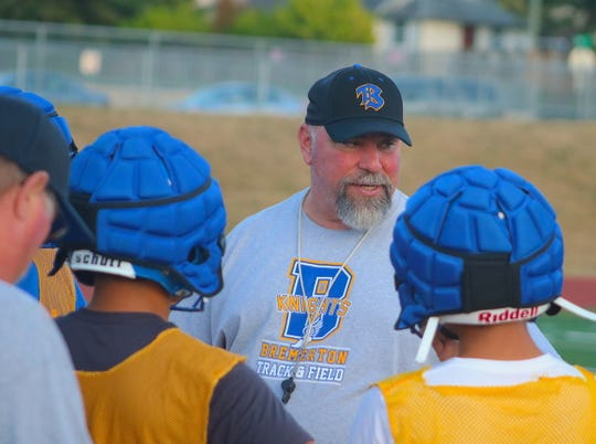 Bremerton football coach Paul Theriault talks to his team during practice on Aug. 22, 2019.