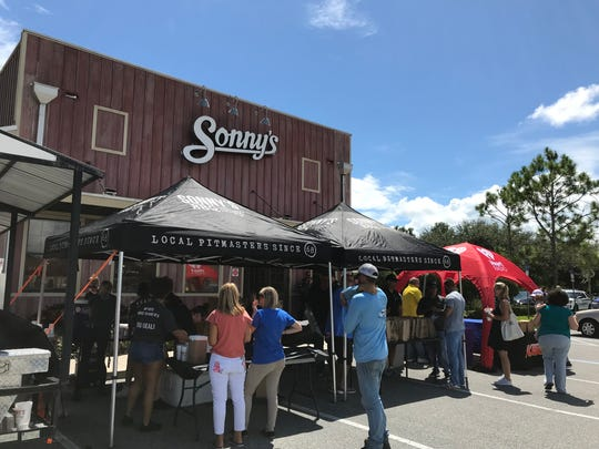 Sonny's BBQ Viera sold $5 meals to support the families of missing firefighters Justin Walker and Brian McCluney.