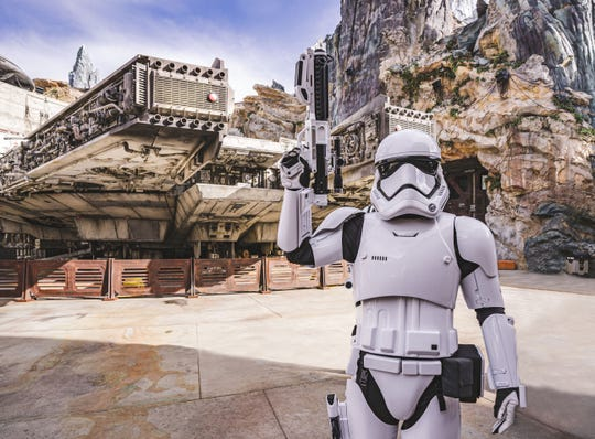 Let me see your identification: A stormtrooper stands in front of the Millennium Falcon: Smuggler's Run attraction at Galaxy's Edge in Hollywood Studios.