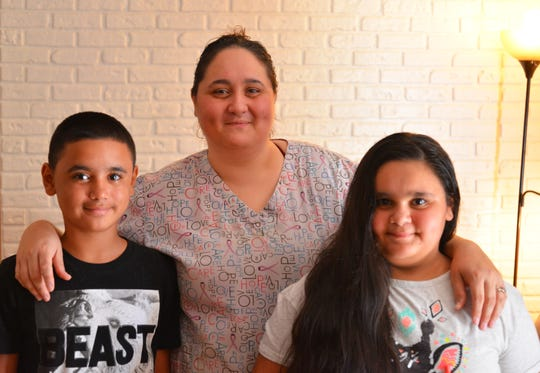 Natasha Feliciano, a single mother with two children, was sleeping on her mother's couch. The home health care worker applied to Community of Hope for assistance, and they put her family in transitional housing in Melbourne. Natasha with her two children, Ricky, 10, and Marisol, 12.