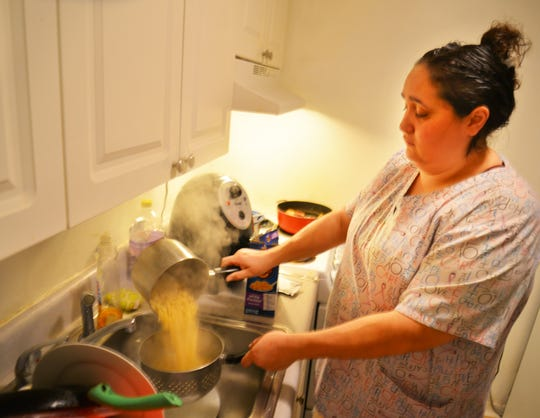Natasha Feliciano rushes home from work to cook dinner before taking her son to football and her daughter to cheerleading. Natasha Feliciano, a single mother with two children, was sleeping on her mother's couch. The home health care worker applied to Community of Hope for assistance, and they put her family in transitional housing in Melbourne.