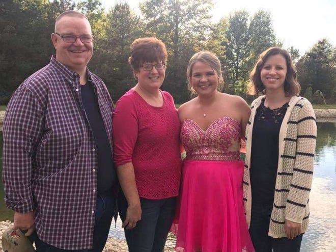 Matt Rudd, Kim Rudd, Emily Rudd and Sara Wheeler, from left, gathered for this family photo before a high school dance a few years ago.