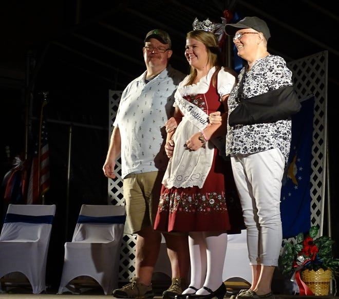 Matt and Kim Rudd accompany their daughter, Emily, center, on stage during the 2019 Bucyrus Bratwurst Festival queen's pageant. Emily was the festival's 2018 queen.