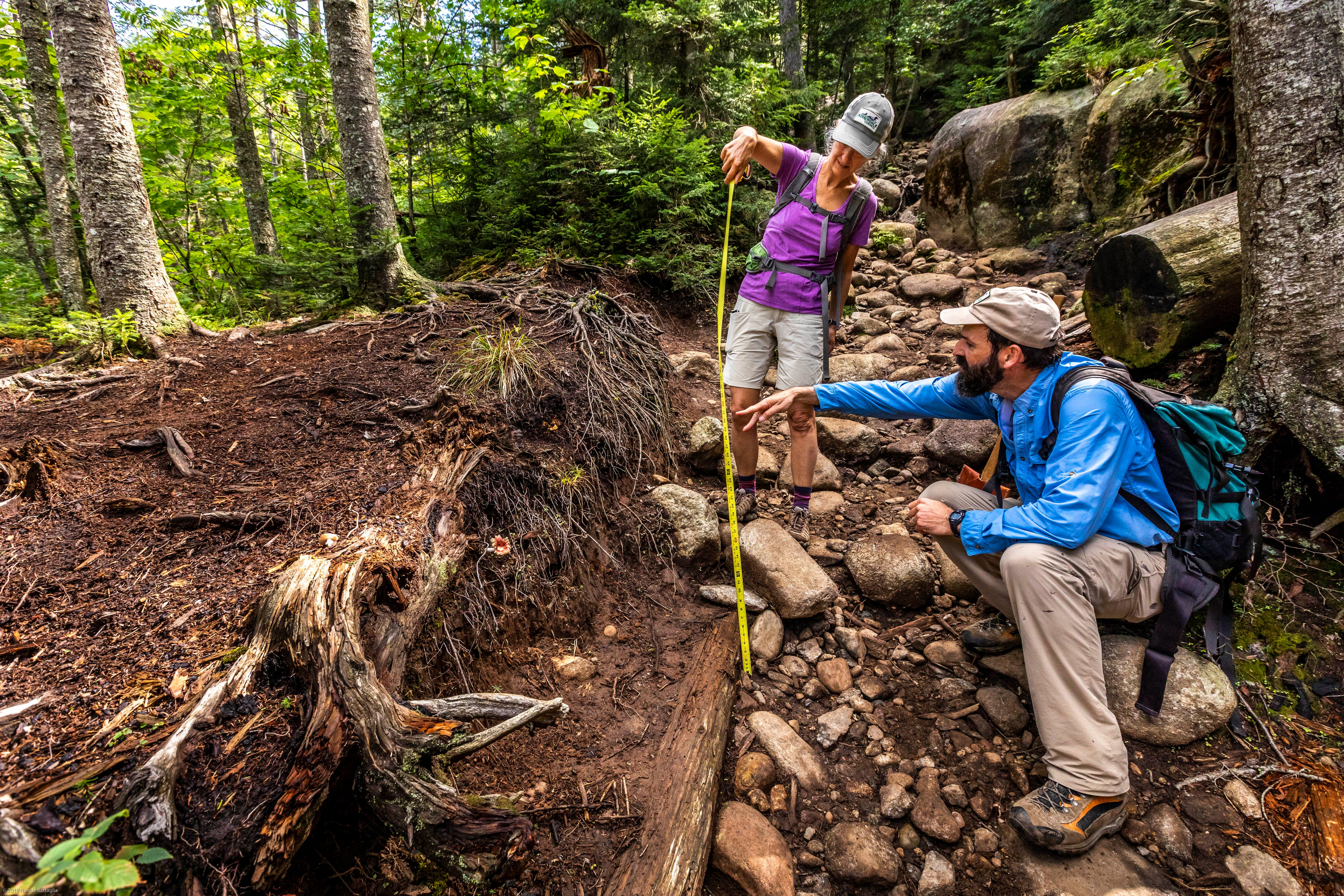 William Janeway, executive director of the nonprofit Adirondack Council, measures trail erosion on Ampersand Mountain in the High Peaks region of the Adirondack Park in August, 2018.